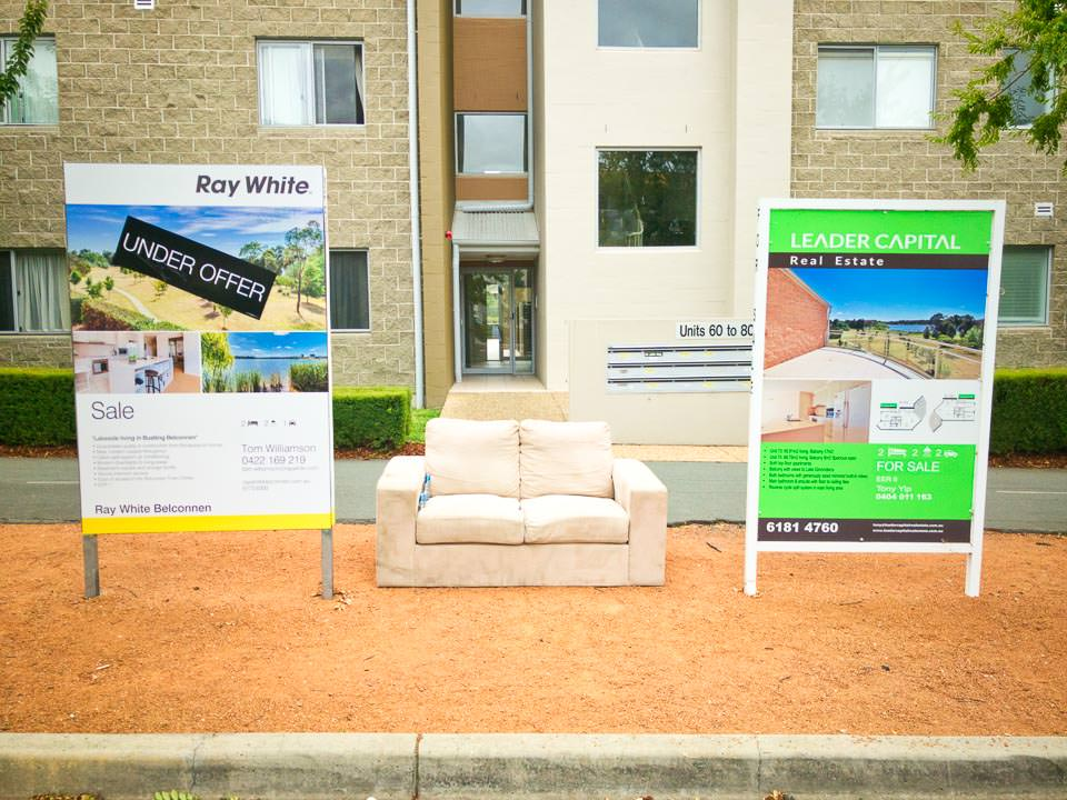 A couch on the sidewalk while you buy an apartment Gary Lum